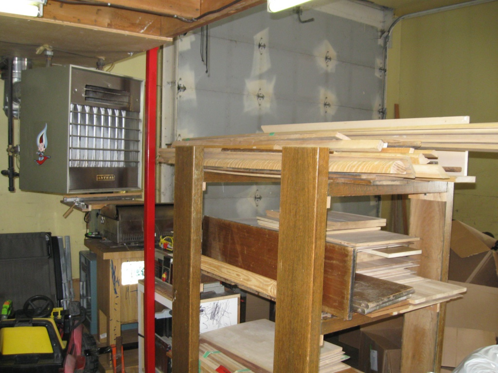 rolling wood storage, heater and 12' door that needs some TLC