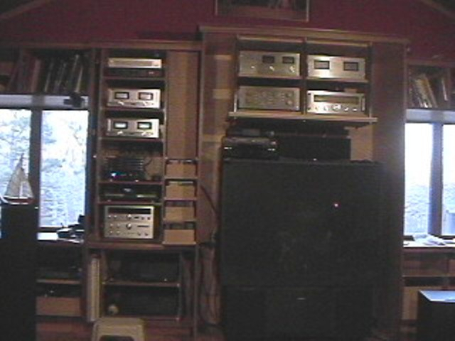 Left of TV (top) Marantz graphic EQ, 300 DC and 170DC power amps, Marchand 2 way active VARIABLE crossover network W/ remote. (Middle) Tube preamp, Harmond Kardon CD player, Kenwood Tuner and pre and power amp.