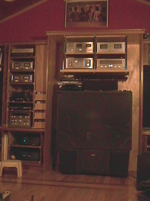 Above the TV, one of my Series 1 Phase Linear families. 4000 pre amp, 700 and 400 power amps (1100 watts) (-; and a 5000 tuner. Also have a couple of full sets of Series 2.
