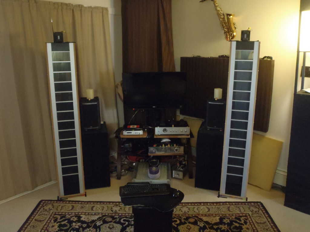 Audiostatic + dit rythmik subs and Raal 70-10 Supertweeter. Parasound A21 amplification. (2014)