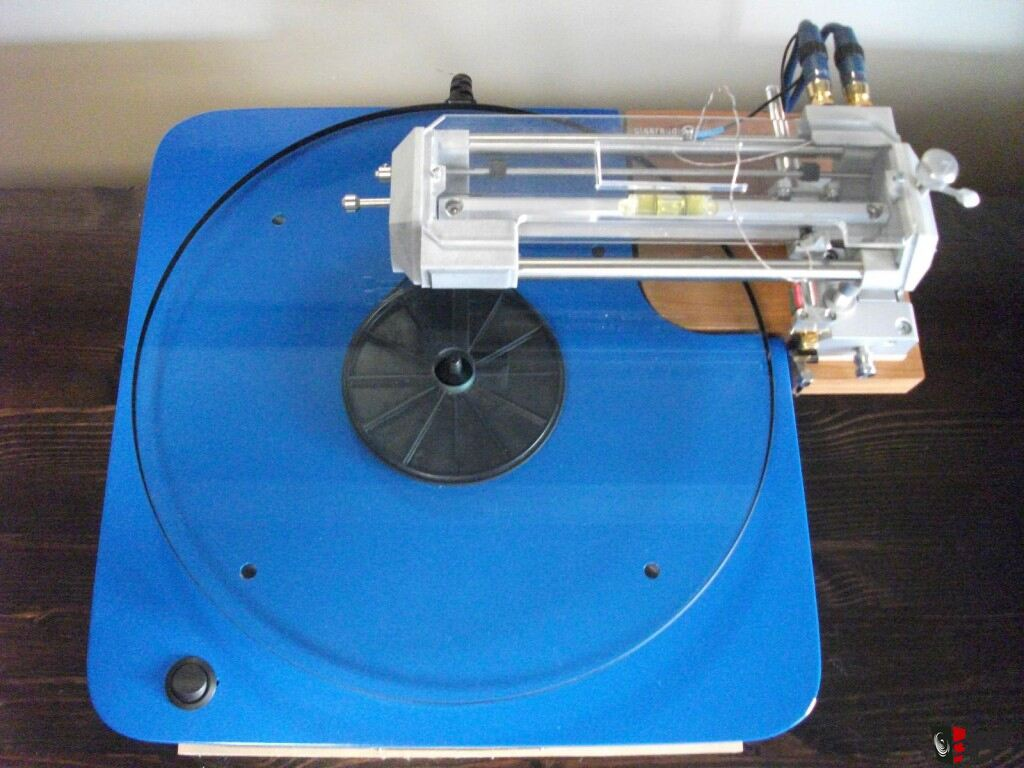 Pro-Ject Xtension 9 Evolution 443348-rega_p324_with_brand_new_clearaudio_tq1_tangential_tracking_arm_gorgeous_with_custom_plinth